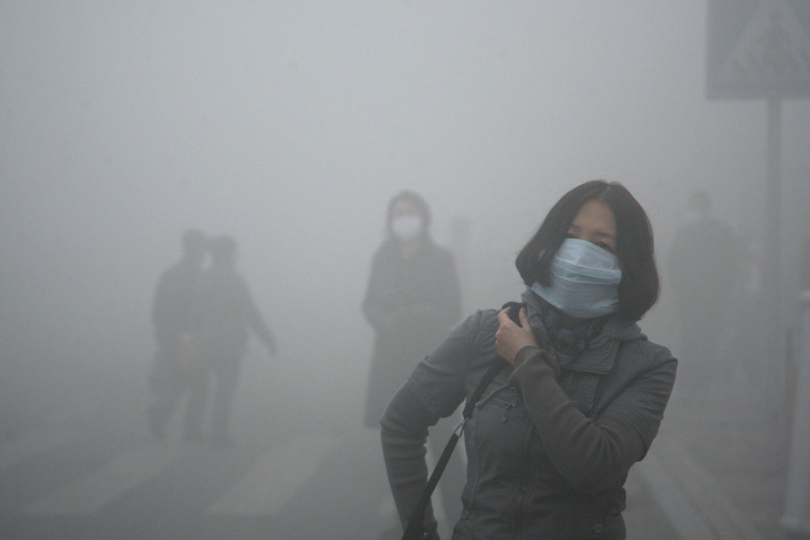 A woman wears a mask as she walks down a street covered by dense smog in Harbin, China   Image credits: galleryhip.com